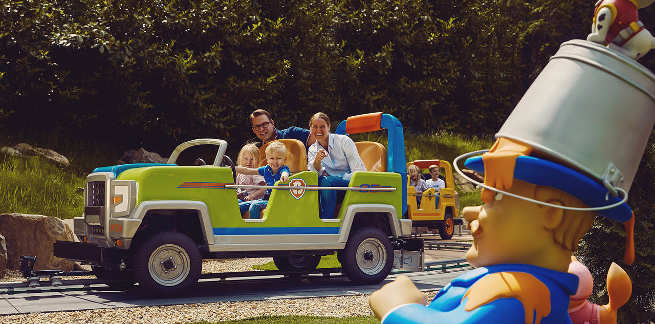 Family in the car attraction at Paw Patrol area at Movie Park Germany