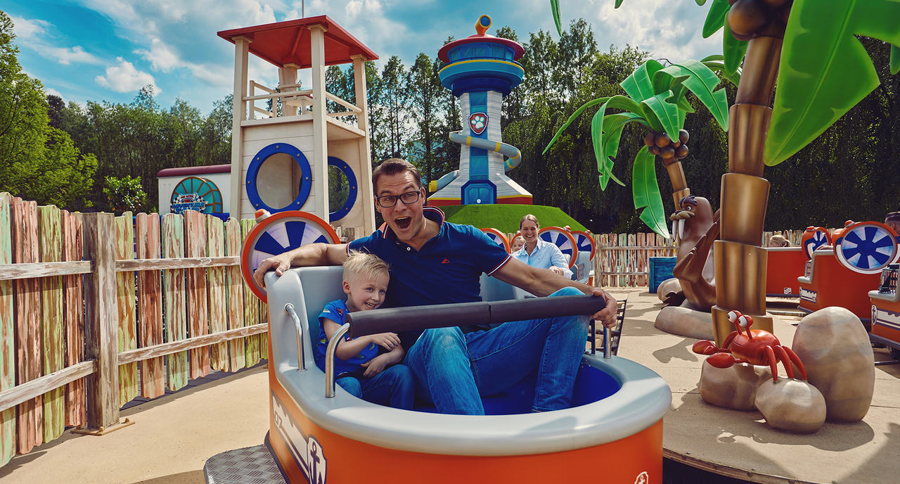 Father and son enjoying the Zuma Zoomers attraction at Paw Patrol area at Movie Park Germany